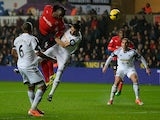 Cardiff's Kenwyne Jones heads wide against Swansea during their Premier League match on February 8, 2014