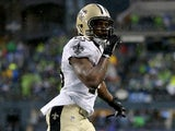 Khiry Robinson #29 of the New Orleans Saints celebrates after scoring on a one-yard touchdown run in the fourth quarter against the Seattle Seahawks on January 11, 2014