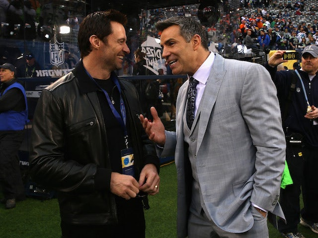 Actor Hugh Jackman (L) and former NFL player Kurt Warner attend the Pepsi Super Bowl XLVIII Pregame Show at MetLife Stadium on February 2, 2014
