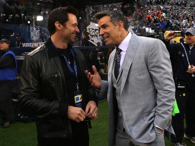 Actor Hugh Jackman (L) and former NFL player Kurt Warner attend the Pepsi Super Bowl XLVIII Pregame Show at MetLife Stadium on February 2, 2014