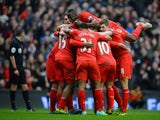 Daniel Sturridge of Liverpool celebrates with his team-mates after scoring the fourth goal during the Barclays Premier League match between Liverpool and Arsenal at Anfield on February 8, 2014