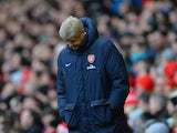 Arsenal Manager Arsene Wenger looks dejected during the Barclays Premier League match between Liverpool and Arsenal at Anfield on February 8, 2014