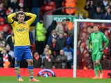 Arsenal's English midfielder Jack Wilshere reacts during the English Premier League football match between Liverpool and Arsenal at Anfield in Liverpool, northwest England, on February 8, 2014