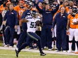 Outside linebacker Malcolm Smith #53 of the Seattle Seahawks runs back an interception off quarterback Peyton Manning of the Denver Broncos on February 2, 2014