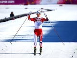 Norway's Marit Bjoergen celebrates winning gold in the women's skiathlon on February 8, 2014.