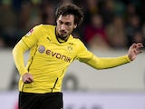Dortmund's Mats Hummels runs with the ball during the German first division Bundesliga football match VfL Wolfsburg vs Borussia Dortmund at the Volkswagen arena in Wolfsburg on November 9, 2013