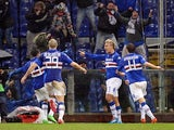 Sampdoria's Maxi Lopez celebrates with teammates after scoring the opening goal against Genoa during their Serie A match on February 3, 2014