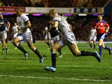 England's Mike Brown runs ahead to score a try against Scotland during their Six Nations match on February 8, 2014