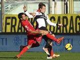 Antonio Cassano of Parma FC competes for the ball with Fabian Andres Rinaudo of Calcio Catania during the Serie A match between Parma FC and Calcio Catania at Stadio Ennio Tardini on February 9, 2014