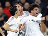 Real Madrid's Pepe celebrates with his teammates after scoring during the Spanish Copa del Rey semi final first-leg against Atletico Madrid on February 5, 2014
