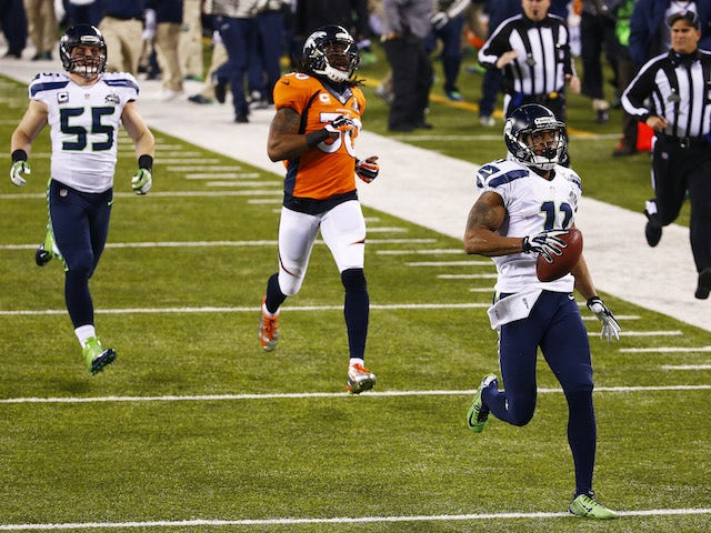 Wide receiver Percy Harvin of the Seattle Seahawks returns the second half kickoff for 87 yards during Super Bowl XLVIII on February 2, 2014