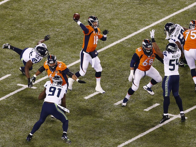 Quarterback Peyton Manning #18 of the Denver Broncos throws an interception during the first quarter of Super Bowl XLVIII on February 2, 2014