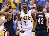 Roy Hibbert #55 of the Indiana Pacers celebrates during overtime in the118-113 win over the Portland Trailblazers at Bankers Life Fieldhouse on February 7, 2014