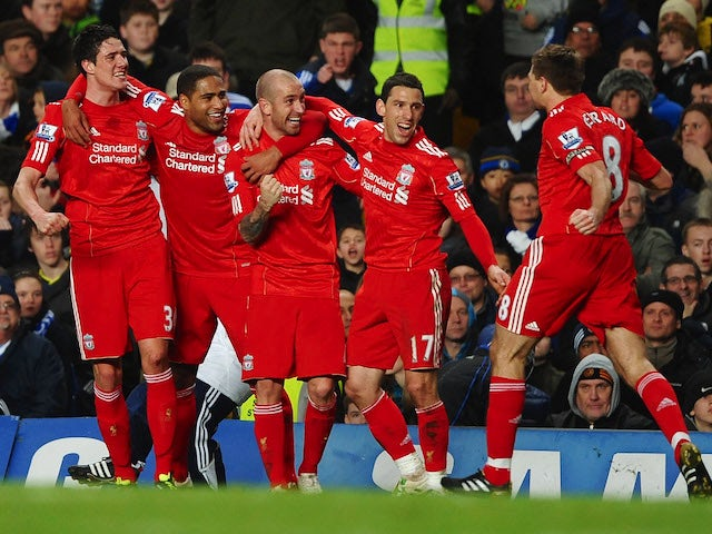 Raul Meireles of Liverpool (C) celebrates with teammates as he scores their first goal during the Barclays Premier League match against Chelsea on February 6, 2011
