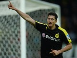 Dortmund's Robert Lewandowski celebrates after scoring his team's fifth goal against Werder Bremen during their Bundesliga match on February 8, 2014