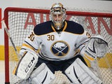 Ryan Miller #30 of the Buffalo Sabres faces a shot in the warm-up prior to playing against the Toronto Maple Leafs during an NHL game at the Air Canada Centre on December 27, 2013