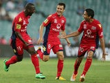 Bruce Djite of Adelaide celebrates scoring a goal with team mates Isaias Sanchez and Marcelo Carrusca during the round 18 A-League match between Sydney FC and Adelaide United at Allianz Stadium on February 8, 2014