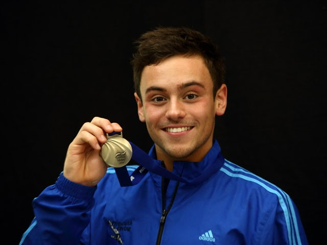 Tom Daley of England holds his gold medal after winning the Mens 10m Platform Final during Day 3 of the British Gas National Cup on February 2, 2014