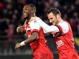 Valenciennes' Tongo Doumbia celebrates after scoring the opening goal against Nice during their Ligue 1 match on February 8, 2014