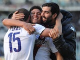 Jonathan Cristaldo of Bologna FC celebrates victory with team-mates at the end of the Serie A match between Torino FC and Bologna FC at Stadio Olimpico di Torino on February 9, 2014