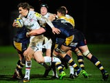 Tigers player Toby Flood makes a break during the Aviva Premiership match between Worcester Warriors and Leicester Tigers at Sixways Stadium on February 7, 2014