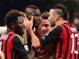 AC Milan's forward Mario Balotelli celebrates with teammate Adil Rami after scoring a goal during the Serie A football match between AC Milan and Bologna at San Siro Stadium in Milan on February 14, 2014
