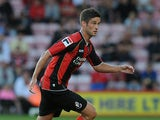 Andrew Surman of Bournemouth attacks during the Capital One Cup First Round match between AFC Bournemouth and Portsmouth at The Goldsands Stadium on August 06, 2013
