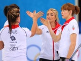 Anna Sloan, Vicki Adams, Claire Hamilton and Eve Muirhead of Great Britain congratulate each other after their win during the Curling Round Robin match against China on February 13, 2014