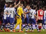Espanyol´s players celebrate their victory at the end of the Spanish league football match Athletic Bilbao vs Espanyol de Barcelona at the San Mames stadium in Bilbao on February 16, 2014