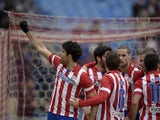 Atletico Madrid's Brazilian forward Diego da Silva Costa celebrates after scoring during the Spanish league football match Club Atletico de Madrid vs Valladolid CF at the Vicente Calderon stadium in Madrid on February 15, 2014