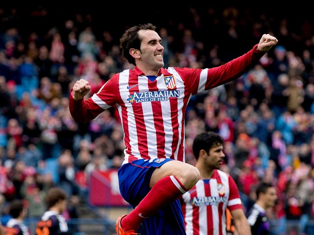 Diego Godin of Atletico de Madrid jumps, celebrating scoring their third goal during the La Liga match between Club Atletico de Madrid and Real Valladolid CF at Vicente Calderon Stadium on February 15, 2014