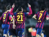 Barcelona's Brazilian defender Adriano Correia celebrates his goal during the Spanish league football match FC Barcelona vs Rayo Vallecano at the Camp Nou stadium in Barcelona on February 15, 2014