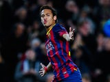 Neymar of FC Barcelona celebrates after scoring his team's sixth goal during the La Liga match between FC Barcelona and Rayo Vallecano de Madrid at Camp Nou on February 15, 2014