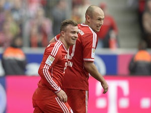 Bayern extend lead in style