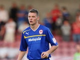 Ben Nugent of Cardiff City in action during the Capital One Cup 1st Round match between Northampton Town and Cardiff City at Sixfields on August 14, 2012