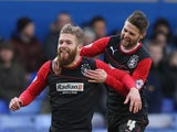 Adam Clayton of Huddersfield Town celebrates his goal with team mate Oliver Norwood during the Sky Bet Championship match between Birmingham City and Huddersfield Town at St Andrews (stadium) on February 15, 2014