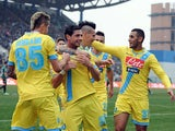 Napoli's Blerim Dzemaili is congratulated by teammates after scoring the opening goal against Sassulo in their Serie A match on February 16, 2014