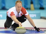Canada's Brad Jacobs releases a stone during the 2014 Sochi winter olympics men's curling round robin session 1 match against Germany at the Ice Cube curling centre in Sochi on February 10, 2014