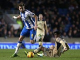Dale Stephens of Brighton skips the tackle from Leeds' Alex Mowatt during the Sky Bet Championship match between Brighton & Hove Albion and Leeds United at The Amex Stadium on Febuary 11, 2014