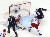 Cam Fowler #3 of the United States scores a goal against Sergei Bobrovski #72 of Russia during the Men's Ice Hockey Preliminary Round Group A game on February 15, 2014
