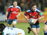 Munster's scrum-half Cathal Sheridan runs with the ball during the rugby union H CUP match between Perpignan and Munster on December 14, 2013