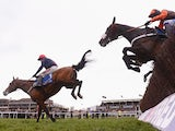Barry Geraghty on Bob's Worth land safely over the last ahead of Long Run and Sir des Champs on their way to victory in the Chentenham Gold Cup Steeple Chase at Cheltenham Racecourse on March 15, 2013
