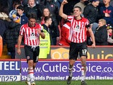 Sheffield United's Conor Coady celebrates after scoring his team's opening goal against Nottingham Forest during their FA Cup fifth round match on February 9, 2014