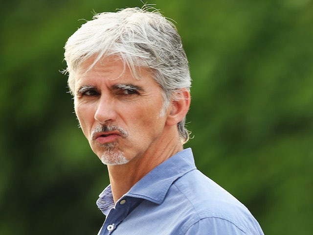 Former F1 World Champion Damon Hill is seen during qualifying for the Chinese Formula One Grand Prix at the Shanghai International Circuit on April 13, 2013
