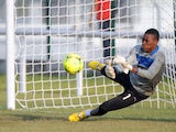 Ghanaian first goalkeeper Daniel Agyei warms up at Ngouoni football field in Gabon on February 2, 2012