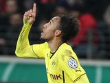 Dortmund's Gabonese striker Pierre-Emerick Aubameyang celebrates scoring during the German Cup (DFB - Pokal) quarter final football match Eintracht Frankfurt vs Borussia Dortmund in Frankfurt am Main, central Germany, on February 11, 2014