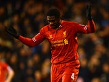 Kolo Toure of Liverpool reacts after he scored an own goal during the Barclays Premier League match between Fulham and Liverpool at Craven Cottage on February 12, 2014