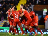 Philippe Coutinho of Liverpool celebrates scoring their second goal with team mates during the Barclays Premier League match between Fulham and Liverpool at Craven Cottage on February 12, 2014