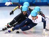 Yuri Confortola of Italy and Jack Whelbourne of Great Britain compete in the Short Track Speed Skating Men's 1500m qualifying on day 3 of the Sochi 2014 Winter Olympics at Iceberg Skating Palace on February 10, 2014
