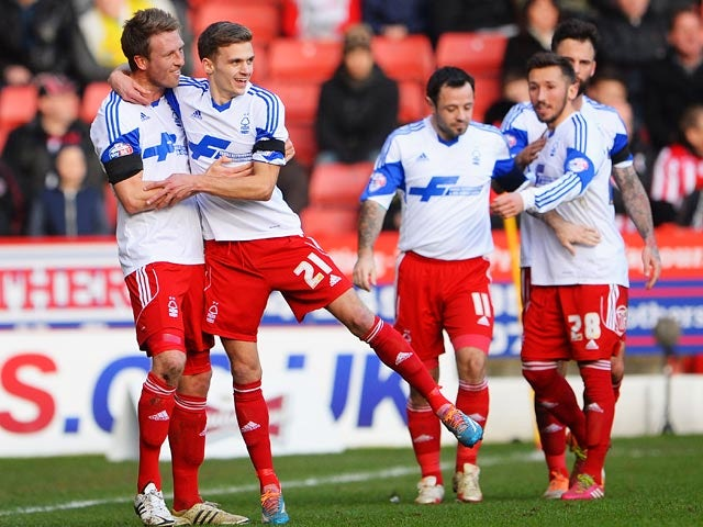 Forest's Jamie Paterson celebrates with teammates after scoring the opening goal against Sheffield United during their FA Cup fifth round match on February 9, 2014